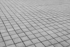 Grey brick stone street road. Light sidewalk, pavement texture Stock Photography