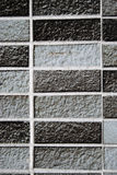 Grey brick wall. A background of a gray, white and black brick wall Royalty Free Stock Photos