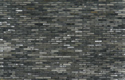 Grey brick wall. Picture of a wall built with grey old bricks in asian styel Stock Photography