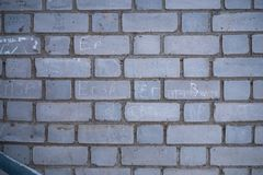 Grey brick wall background stock images