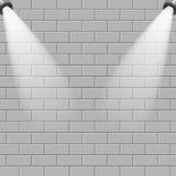 Grey brick wall is illuminated by the rays of light Stock Photography