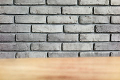 Grey Brick wall with table foreground Royalty Free Stock Photos