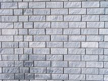 Grey brick wall texture. Rugged grey  brick wall background Stock Photos