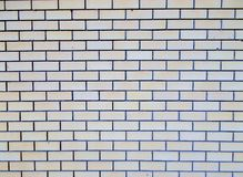 Grey brick wall texture. Grey with Yellowish hue brick wall background Stock Images