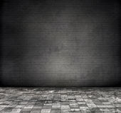 Grey brick wall. With grey, tile floor.  Gray tone color modification Royalty Free Stock Photo