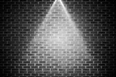 Grey brick wall under spotlight Royalty Free Stock Photos