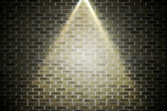 Grey brick wall under spotlight Royalty Free Stock Photography