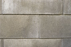 Grey bricks. Grey horizontal bricks in stone outside Royalty Free Stock Photography