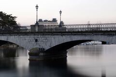 Grey Bridge With Light Post Under White Sky during Daytime Royalty Free Stock Images