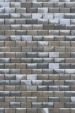 Grey bright dark brown wet weathered decorative abstract brick wall vertical Stock Photos