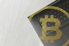 Grey BTC bitcoin laptop top-down view for home office business concept. Cop stock image