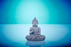 Grey buddah in lotus pose Stock Photography