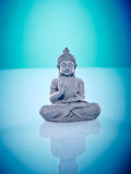 Grey buddah in lotus pose. Wellness and Spa Image, works perfect for advertising Health and Beauty, Spirituality or Massage Stock Image