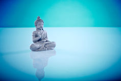 Grey buddah in lotus pose. Wellness and Spa Image, works perfect for advertising Health and Beauty, Spirituality or Massage Stock Photos