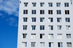 Grey building with big windows Royalty Free Stock Images
