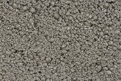 Grey bumpy concrete texture. Close-up of grey coarse bumpy industrial concrete texture, building material royalty free stock photography