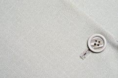 Grey button on jacket Stock Photos