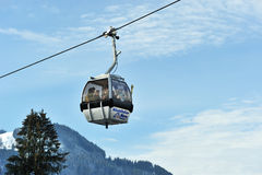 Grey cable cars in Eastern Alps in Kitzbuhel. Kitzbuhel Austria in December 2011. Cable cars take tourits to the ski slope royalty free stock photos