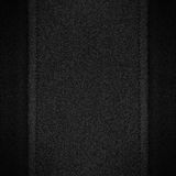 Grey canvas background on black leather Stock Photos