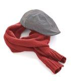 Grey cap and vinous warm scarf. On a white background stock photos