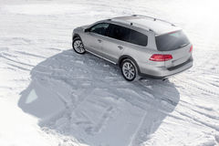 Grey car stay on snow road at winter sunny day Stock Photos
