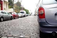 Grey car on the street Royalty Free Stock Photography