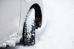 Grey car with winter tyre in the snow Stock Photo