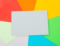 Grey card on color sheets of paper Royalty Free Stock Photography