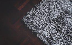 Grey carpet on parquet. A grey carpet on parquet floor Royalty Free Stock Photo