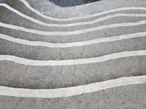 Grey cement steps or stairs with white stripes. Grey cement steps or stairs or staircase with white safety stripes royalty free stock photography