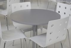 Grey chairs and table Stock Photography