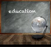 A grey chalkboard wooden table. Education concept Royalty Free Stock Image