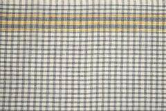 Grey checkered dishtowel backgrounds Stock Images