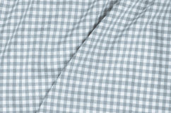 Grey checkered fabric tablecloth Royalty Free Stock Images