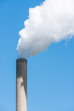 Grey chimney with white smoke Stock Photography