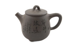 Grey chinese teapot with hieroglyphic ornament Royalty Free Stock Images