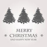 Grey christmas card with christmas trees Stock Photography