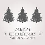 Grey christmas card with christmas trees Stock Photography