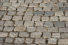Grey city pavement. Granite gray town pavement close-up as background stock photo