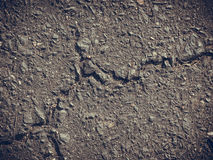 Grey clay, concrete wall with cracks Royalty Free Stock Photo