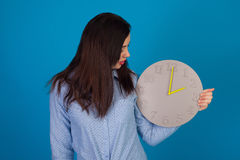 With grey clock in hand Royalty Free Stock Image