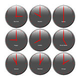 Grey clocks with glossy area showing world time, the red pointer Royalty Free Stock Photography