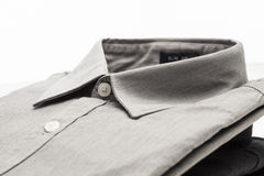 Grey cloth dress shirt folded. Grey dress shirt pressed, folded and buttoned Stock Photo