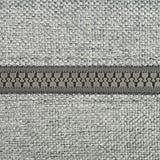 Grey cloth with a zipper Stock Photos