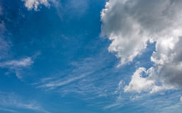 Grey cloud on a blue summer sky Stock Photography