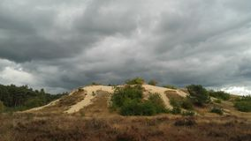 Grey clouds above sand dune Stock Photography