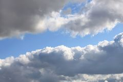 Grey clouds in blue sky. Grey clouds in the blue sky nature background Royalty Free Stock Image