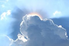 Grey clouds with the dazzling sun shining from the back. Texture Background, Beauty in Nature stock photography