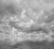 Grey clouds flying over sea. Royalty Free Stock Image