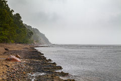 Grey clouds over Baltic sea sand coast.  Royalty Free Stock Image